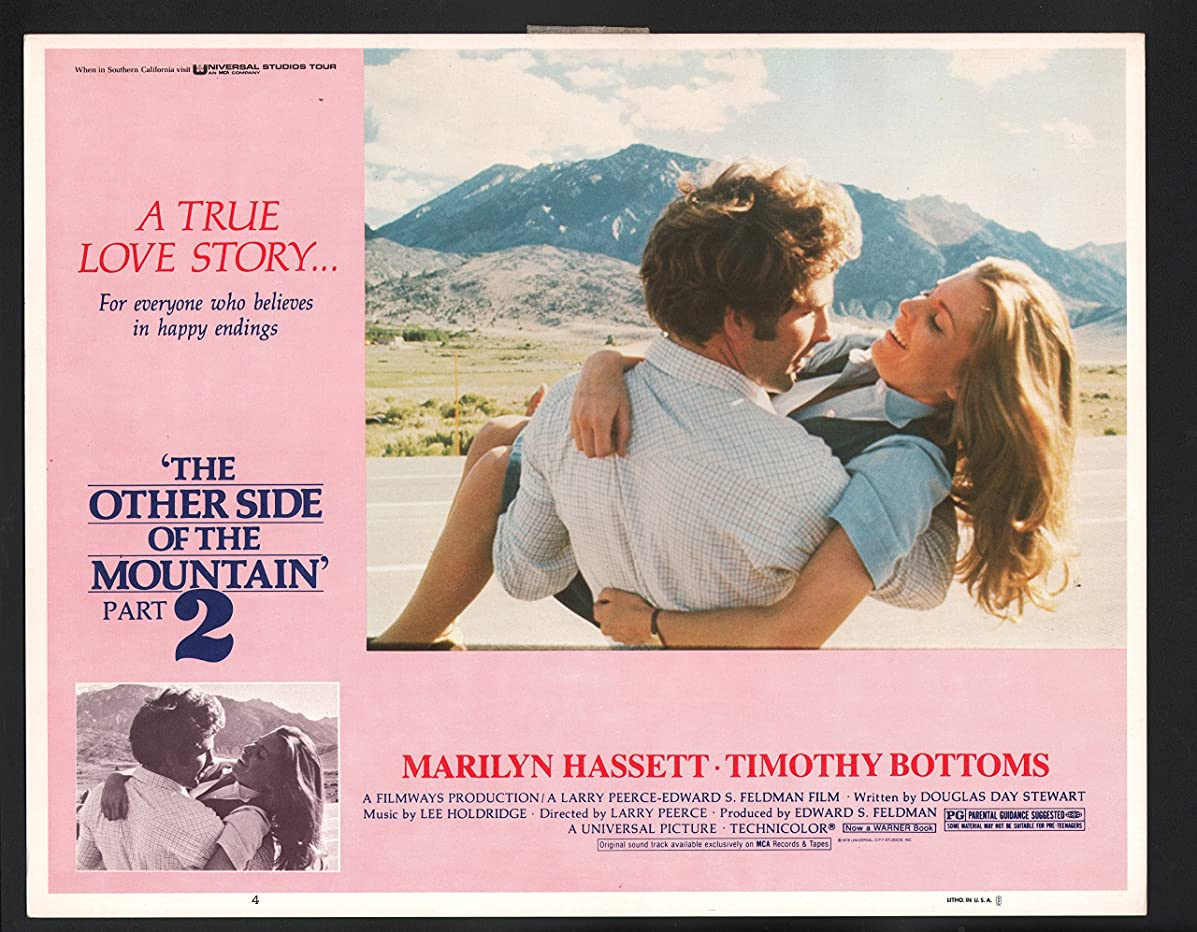 MOVIE POSTER: Other Side of the Mountain Lobby Card-Timothy Bottoms carrying Marilyn Hassett.