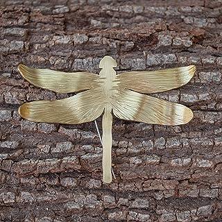 Broche libélula para mujer en color dorado y textura martillada.