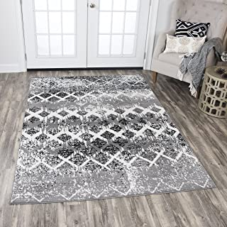 white and black geometric rug