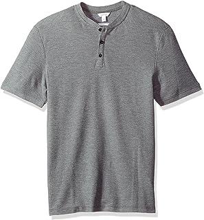 قميص بولو بيكيه قطني مضلع باكمام قصيرة للرجال من كالفن كلاين