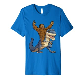 f8ba3c4f5 Image Unavailable. Image not available for. Color: Bigfoot Sasquatch Riding  Dinosaur T rex T shirt Funny Gifts