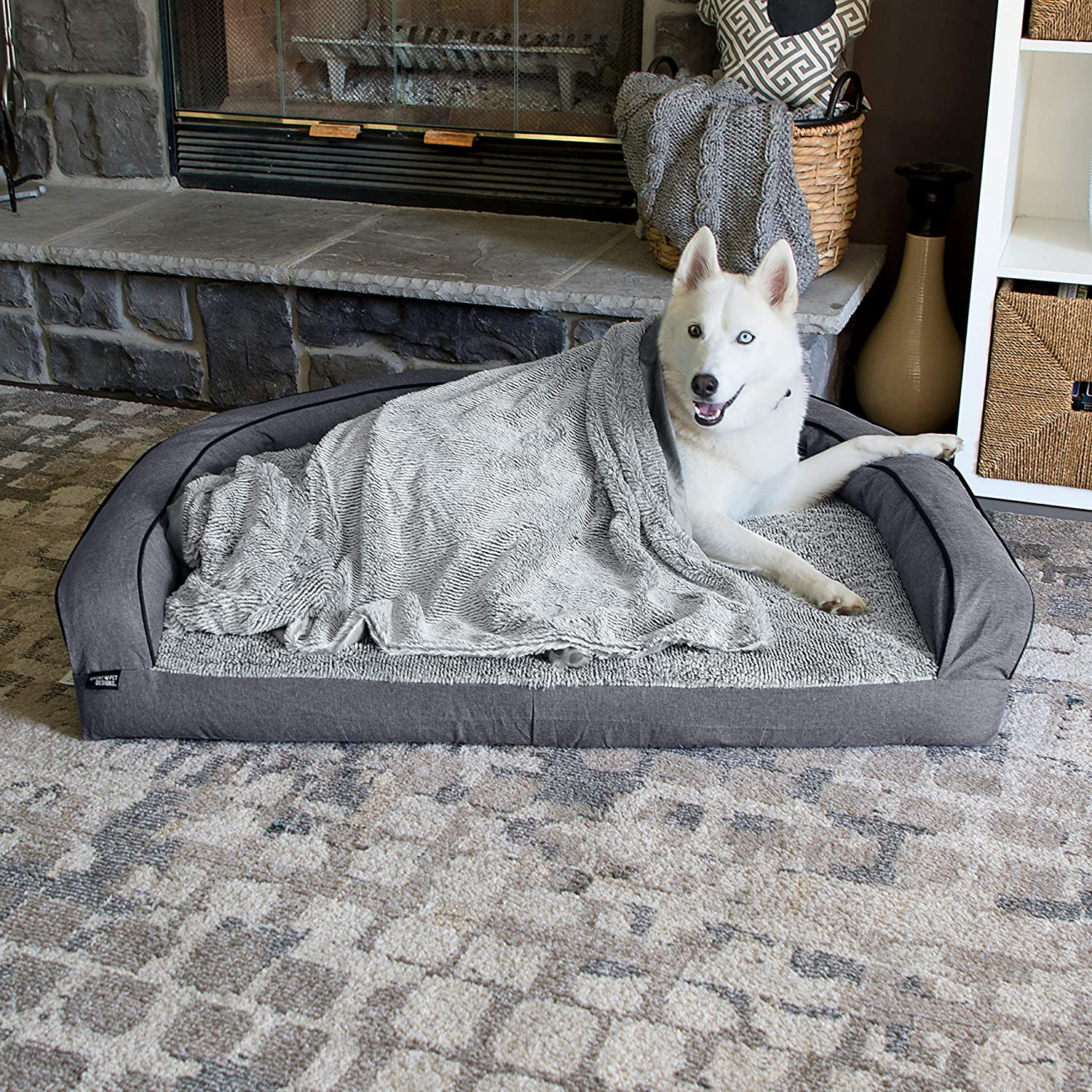 Dog relaxing on extra large dog. bed