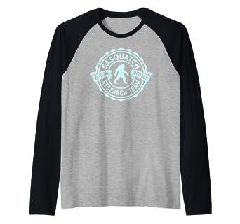 c270aae1612a Amazon.com: Sasquatch Official Bigfoot Research Team Hide & Seek Champ  Raglan Baseball Tee: Clothing