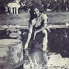 Pyari Begum in Mukh O Mukhosh (1956)