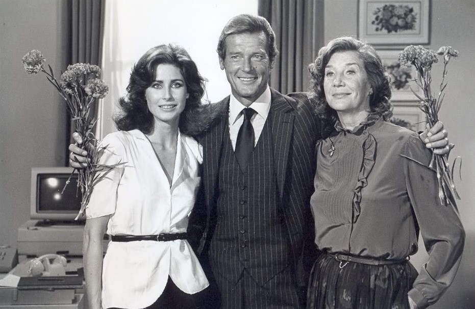 Roger Moore, Michaela Clavell, and Lois Maxwell in Octopussy (1983)