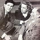 Walter Brennan, John Garfield, and Geraldine Fitzgerald in Nobody Lives Forever (1946)