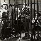 Kenne Duncan, John 'Dusty' King, David Sharpe, and Max Terhune in Texas to Bataan (1942)