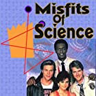 Courteney Cox, Kevin Peter Hall, Dean Paul Martin, and Mark Thomas Miller in Misfits of Science (1985)