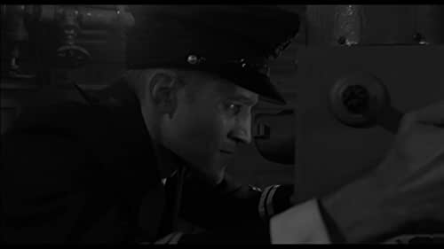 A short film set inside a German submarine during the First World War.  Following the misjudgment of its ambitious young captain, a WWI U-boat is forced to wait for a prolonged period on the bottom of the North Sea, facing the threat of enemy torpedo ships. This will cause unprecedented physical and mental challenges for the captain and the whole crew.  This film was shot on B&W 35mm in a purpose built set. Made as a term 4 exercise at the London Film School and produced in London (UK) in 2017.