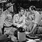 Douglas Fairbanks Jr., Alan Hale, and John Howard in Green Hell (1940)