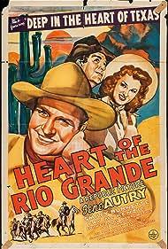 Gene Autry, Smiley Burnette, and Fay McKenzie in Heart of the Rio Grande (1942)