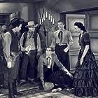 Don 'Red' Barry, Virginia Carroll, Milburn Stone, and Nick Thompson in The Phantom Cowboy (1941)