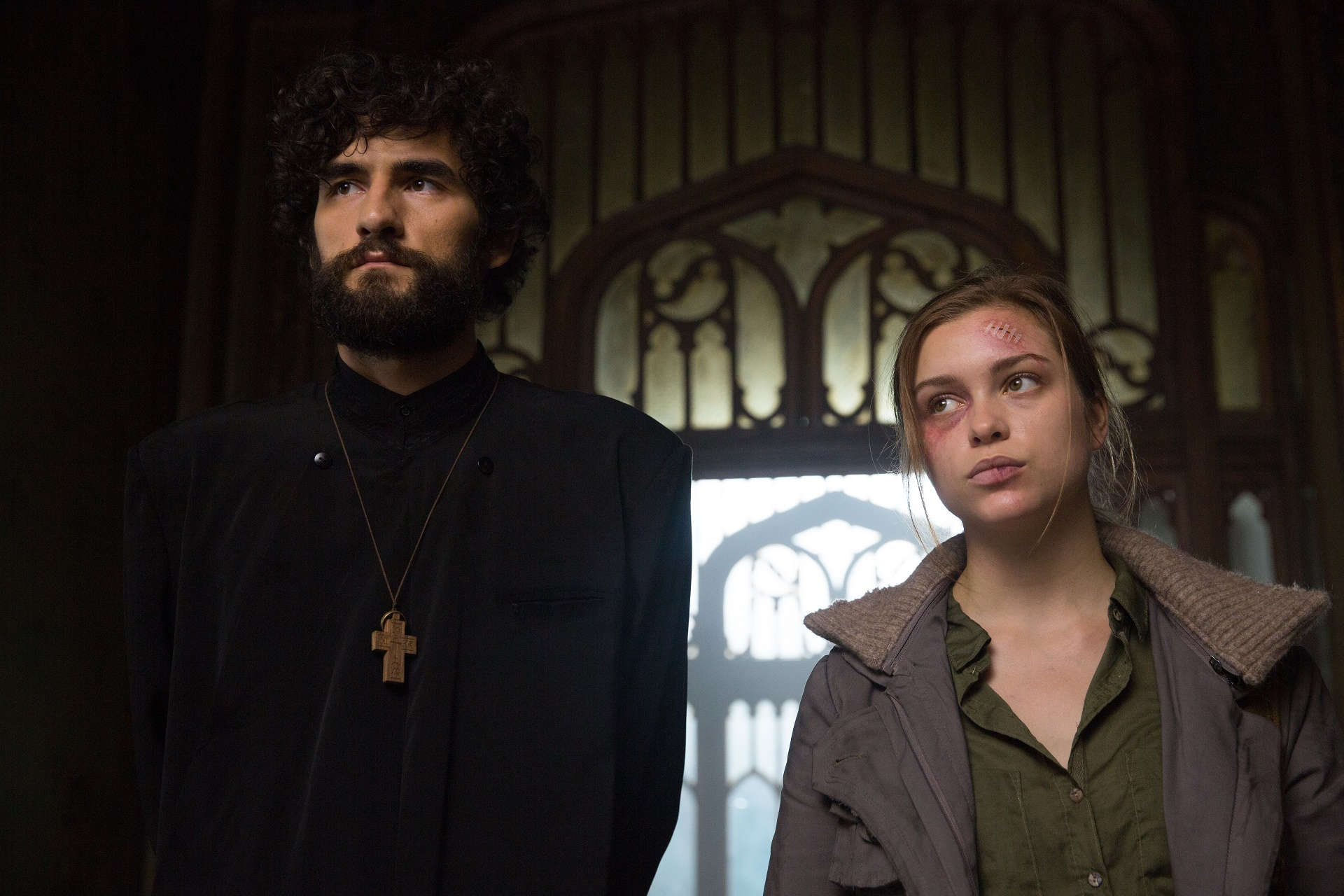 Corneliu Ulici and Sophie Cookson in The Crucifixion (2017)