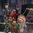 The Great Gonzo, Kermit the Frog, and Miss Piggy in The Muppet Christmas Carol (1992)