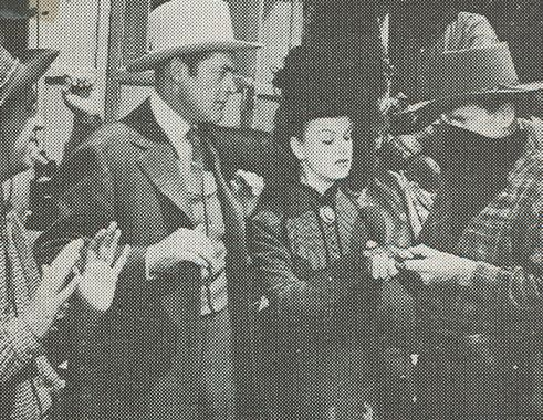 Ray Bennett, Charles Starrett, Jean Stevens, and Britt Wood in The Return of the Durango Kid (1945)
