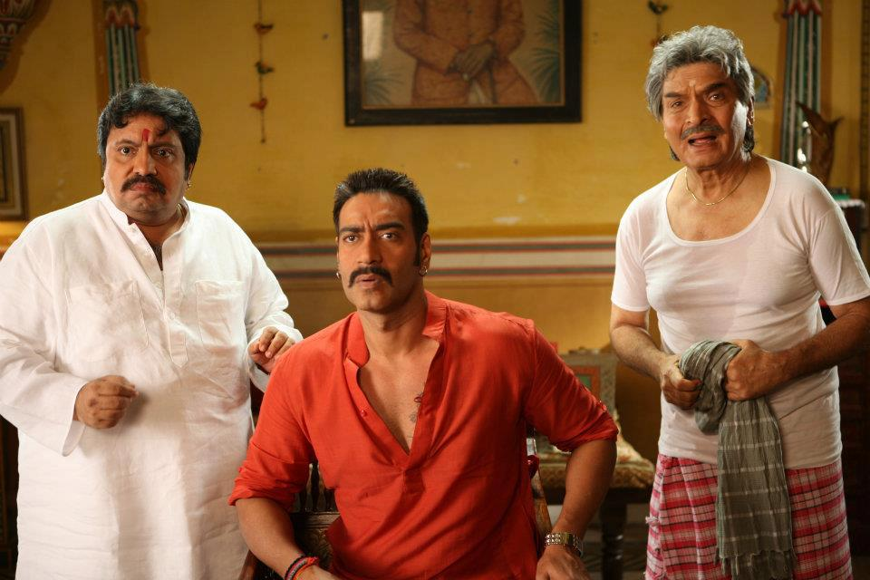 Ajay Devgn, Neeraj Vora, and Asrani in Bol Bachchan (2012)