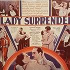 Basil Rathbone, Rose Hobart, Carmel Myers, Conrad Nagel, Edgar Norton, Vivien Oakland, Franklin Pangborn, and Genevieve Tobin in A Lady Surrenders (1930)
