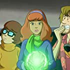 Matthew Lillard, Grey Griffin, Frank Welker, and Kate Micucci in Scooby-Doo! and the Curse of the 13th Ghost (2019)
