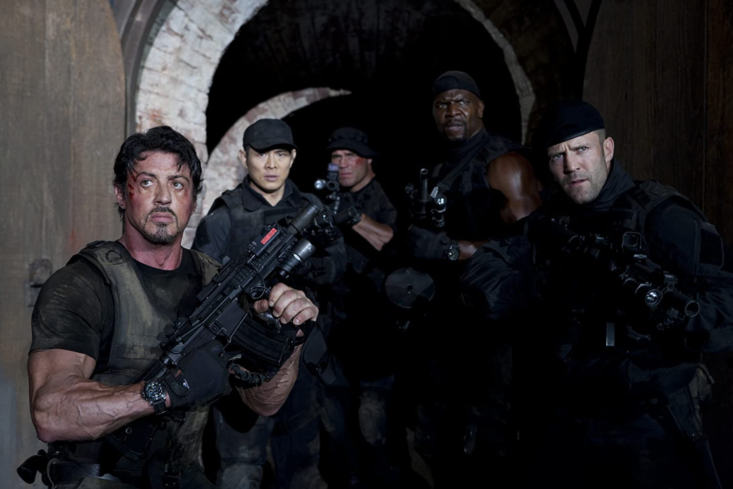 Sylvester Stallone, Jet Li, Jason Statham, Terry Crews, and Randy Couture in The Expendables (2010)