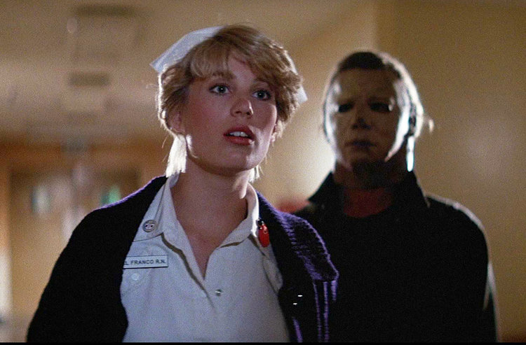 Dick Warlock and Tawny Moyer in Halloween II (1981)