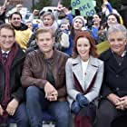 Joe Theismann, Lindy Booth, Ed Marinaro, and Trevor Donovan in SnowComing (2019)
