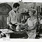 Ginger Rogers and Jacques Bergerac in Beautiful Stranger (1954)
