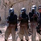 Juan Garcia, Breck A. Graham, Benjamin Sitzer, and Peter Vasquez in Robot Wars (1993)