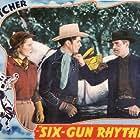 Joan Barclay, Tex Fletcher, and Reed Howes in Six-Gun Rhythm (1939)