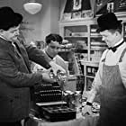 Oliver Hardy, Charlie Hall, and Stan Laurel in Tit for Tat (1935)