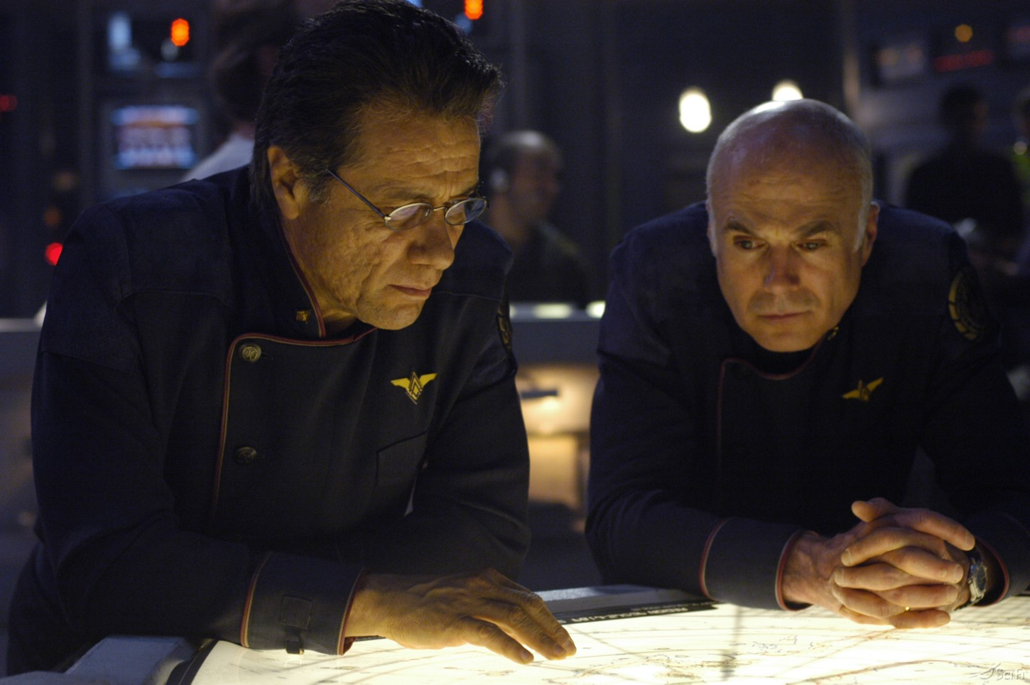 Edward James Olmos and Michael Hogan in Battlestar Galactica (2004)