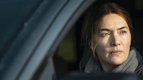 """Academy Award®-winner Kate Winslet plays Mare Sheehan, a small-town Pennsylvania detective who investigates a local murder as life crumbles around her. From creator and writer Brad Ingelsby (""""The Way Back""""), with all episodes directed by Craig Zobel (HBO's """"The Leftovers""""), the seven-part limited series is an exploration into the dark side of a close community and an authentic examination of how family and past tragedies can define our present."""