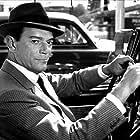 Eddie Constantine in La môme vert de gris (1953)