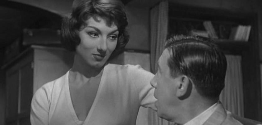 Fernandel and Judith Magre in L'homme à l'imperméable (1957)