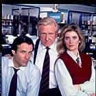 Helen Slater, Lloyd Bridges, and Michael Woods in Capital News (1990)