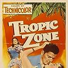 Ronald Reagan, Rhonda Fleming, and Estelita Rodriguez in Tropic Zone (1953)