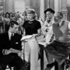 Cary Grant, Tom D'Andrea, Monty Woolley, and Jane Wyman in Night and Day (1946)