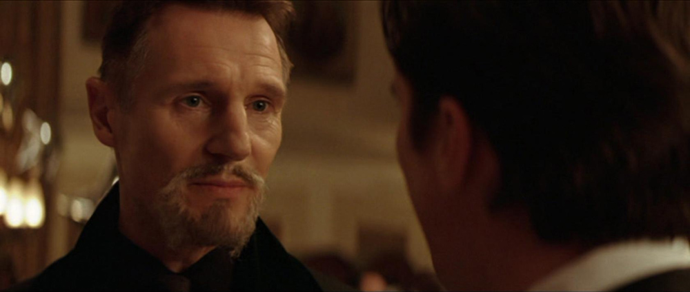 Christian Bale and Liam Neeson in Batman Begins (2005)
