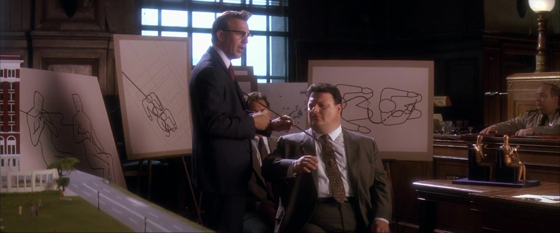 Kevin Costner, Wayne Knight, and Gary Grubbs in JFK (1991)