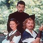 Rowan Atkinson, Rik Mayall, and Kate Moss in Blackadder Back & Forth (1999)
