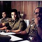 Arjun Sarja, Kamal Haasan, and K. Viswanath in Kuruthipunal (1995)