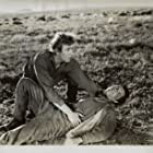 James Craig and Peter Whitney in Valley of the Sun (1942)