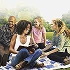Vanessa Williams, Rockmond Dunbar, Victoria Staley, and Kyla Kenedy in Raising Izzie (2012)