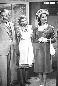 Hans Leibelt, Carsta Löck, Carla Rust, and Rolf Weih in Ein fröhliches Haus (1944)