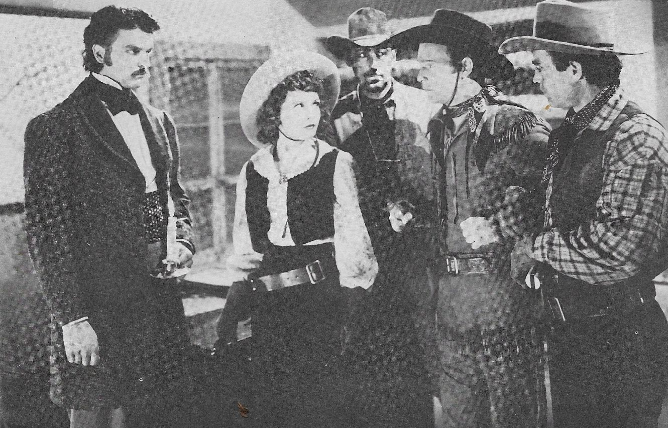 Roy Rogers, Chuck Baldra, Julie Bishop, and Henry Brandon in The Ranger and the Lady (1940)