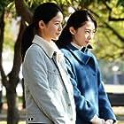 Yoo-rim Park and Sonia Yuan in Doraibu mai kâ (2021)