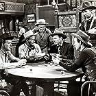 Mike Ragan, Dee Cooper, Kenne Duncan, Dennis Moore, Marshall Reed, Dub Taylor, and Jimmy Wakely in Roaring Westward (1949)