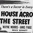 Wayne Morris and Janis Paige in The House Across the Street (1949)