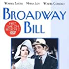 Myrna Loy, Warner Baxter, and Walter Connolly in Broadway Bill (1934)