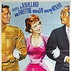 Olivia de Havilland, John Forsythe, and Adolphe Menjou in The Ambassador's Daughter (1956)