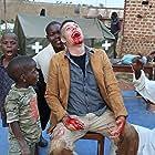 Alan Hofmanis and Bukenya Charles in Bad Black (2016)